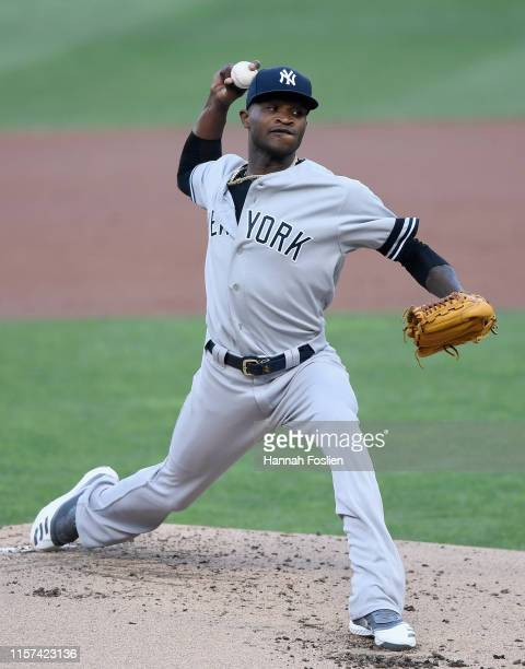 Domingo German of the New York Yankees delivers a pitch against the Minnesota Twins during the first inning of the game on July 23 2019 at Target...