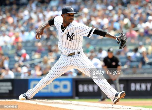 Domingo German of the New York Yankees delivers a pitch in the first inning against the Boston Red Sox during game one of a double header at Yankee...