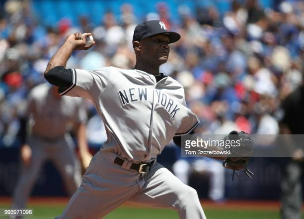Domingo German of the New York Yankees delivers a pitch in the first inning during MLB game action against the Toronto Blue Jays at Rogers Centre on...