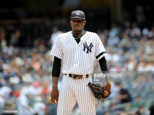 Domingo German of the New York Yankees gets ready to pitch in the first inning against the Boston Red Sox during game one of a double header at...
