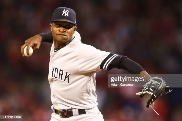 Domingo German of the New York Yankees pitch sin the first inning of a game against the Boston Red Sox at Fenway Park on September 6 2019 in Boston...