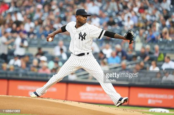 Domingo German of the New York Yankees pitches against the Baltimore Orioles during their game at Yankee Stadium on August 11 2019 in New York City