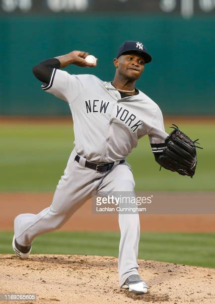 Domingo German of the New York Yankees pitches in the bottom of the first inning against the Oakland Athletics at Ring Central Coliseum on August 20...