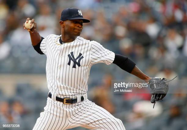 Domingo German of the New York Yankees pitches in the first inning against the Cleveland Indians at Yankee Stadium on May 6 2018 in the Bronx borough...
