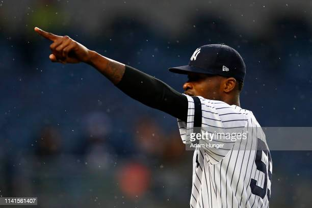 Domingo German of the New York Yankees points to the stands as he exits the game against the Minnesota Twins during the seventh inning at Yankee...