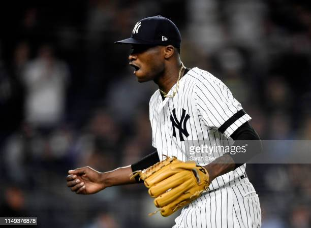 Domingo German of the New York Yankees reacts after coming out of the game during the seventh inning of game two of a double header against the...