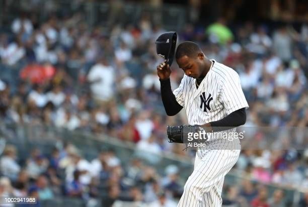 Domingo German of the New York Yankees reacts after giving up three runs in the first inning against the New York Mets during their game at Yankee...