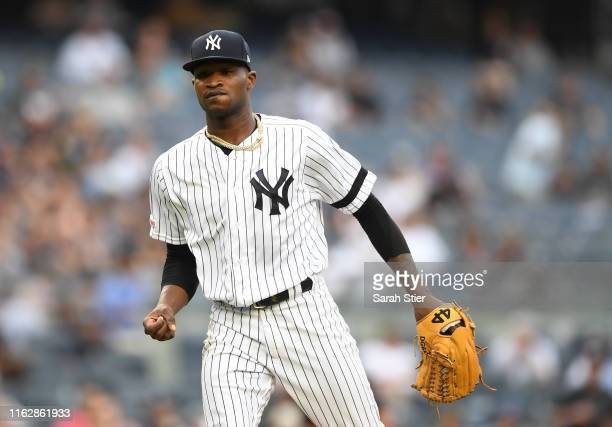 Domingo German of the New York Yankees reacts after striking out a better during the fifth inning of game one of a doubleheader against the Tampa Bay...