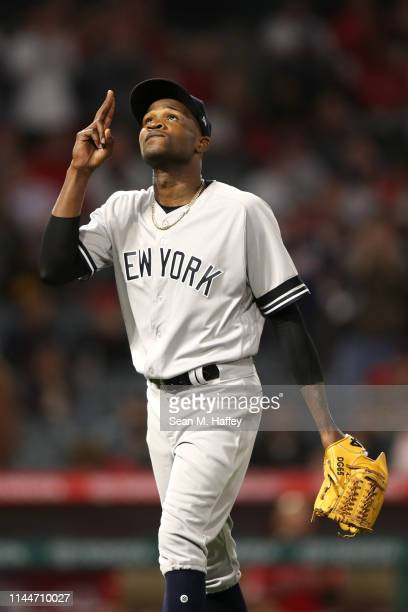 Domingo German of the New York Yankees reacts as he leaves the game during the seventh inning of a game against the Los Angeles Angels of Anaheim at...