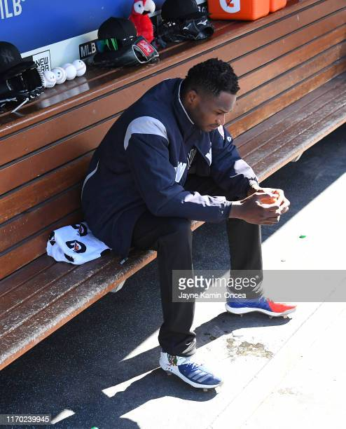 Domingo German of the New York Yankees sits in the dugout before the start of the game against the Los Angeles Dodgers at Dodger Stadium on August 25...
