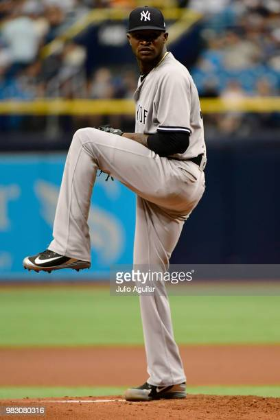 Domingo German of the New York Yankees throws a pitch in the first inning against the Tampa Bay Rays on June 24 2018 at Tropicana Field in St...