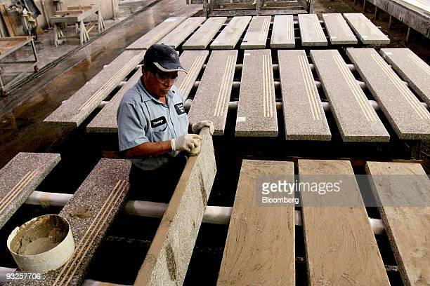 Domingo Gomez rubs grout into precast terrazzo fauxmarble stair treads at the Precast Terrazzo Enterprises Inc manufacturing facility in Raleigh...