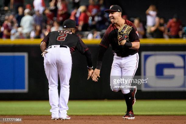 Domingo Leyba and Josh Rojas of the Arizona Diamondbacks celebrate after defeating the against the San Diego Padres 65 at Chase Field on September 28...