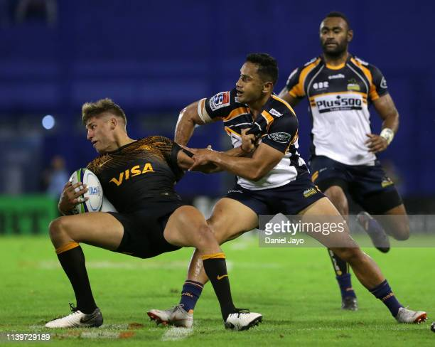 Domingo Miotti of Jaguares and Toni Pulu of Brumbies grab each other during a Super Rugby Rd 11 match between Jaguares and Brumbies at Jose...