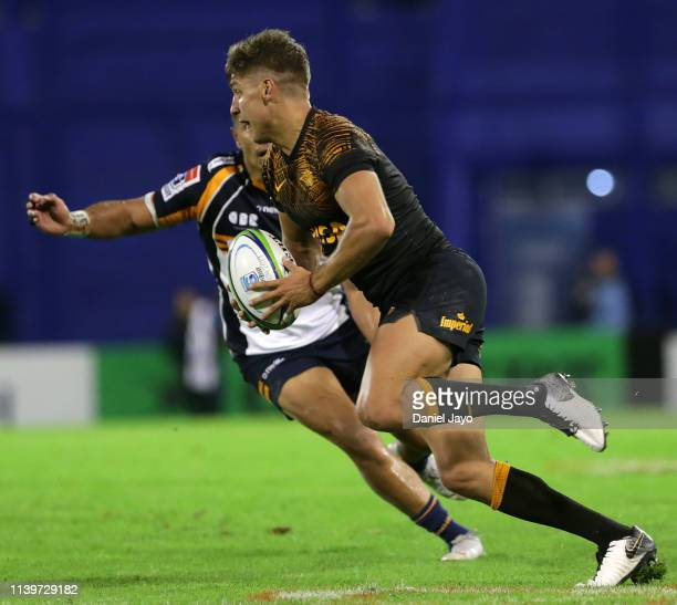 Domingo Miotti of Jaguares dribbles past Toni Pulu of Brumbies during a Super Rugby Rd 11 match between Jaguares and Brumbies at Jose Amalfitani...