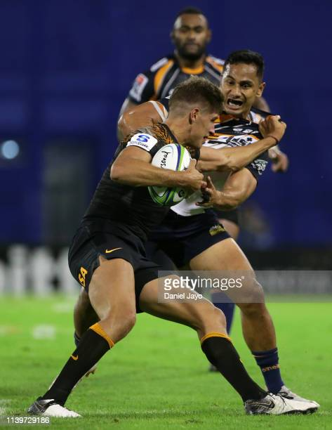 Domingo Miotti of Jaguares grabs Toni Pulu of Brumbies during a Super Rugby Rd 11 match between Jaguares and Brumbies at Jose Amalfitani Stadium on...