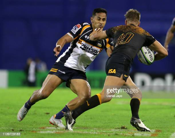 Domingo Miotti of Jaguares hands off Toni Pulu of Brumbies during a Super Rugby Rd 11 match between Jaguares and Brumbies at Jose Amalfitani Stadium...