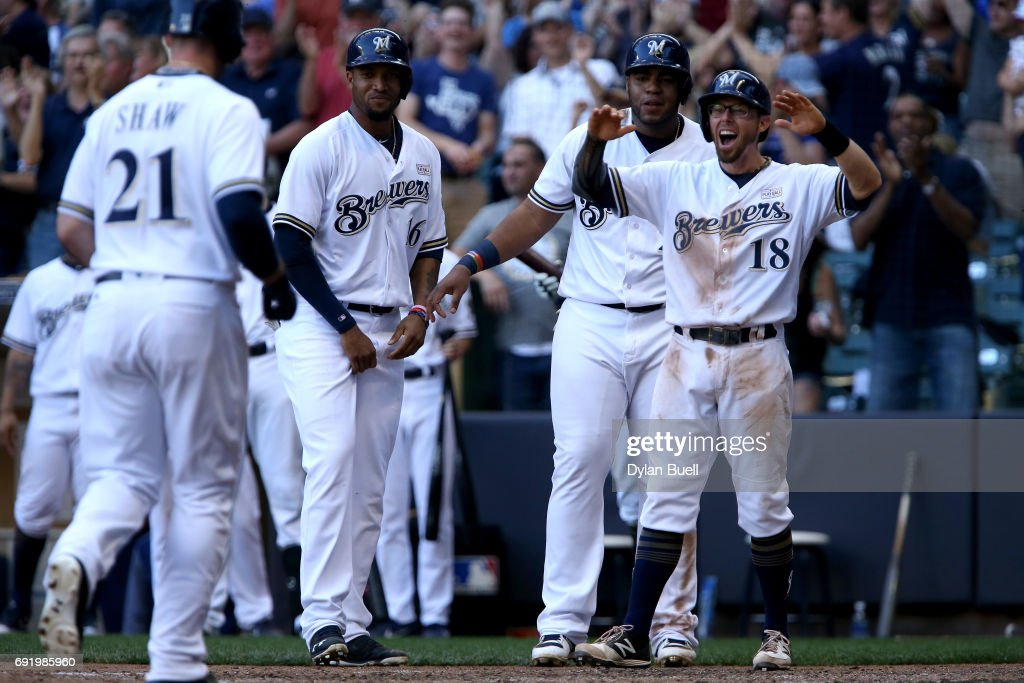 Domingo Santana #16, Jesus Aguilar #24, and Eric Sogard #18 of the Milwaukee Brewers wait to congratulate Travis Shaw #21 after Shaw hit a grand slam in the seventh inning against the Los Angeles Dodgers at Miller Park on June 3, 2017 in Milwaukee, Wisconsin.