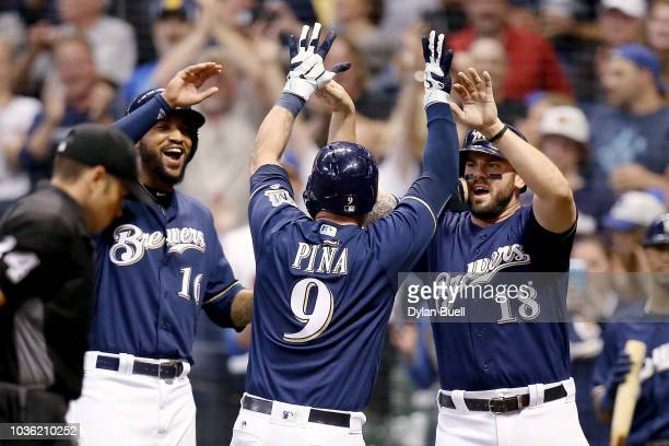 Domingo Santana Manny Pina and Mike Moustakas of the Milwaukee Brewers celebrate after Pina hit a home run in the sixth inning against the Cincinnati...