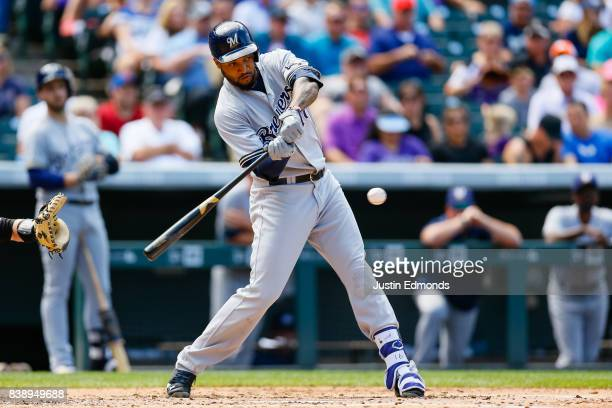 Domingo Santana of the Milwaukee Brewers bats during a game against the Colorado Rockies at Coors Field on August 20 2017 in Denver Colorado