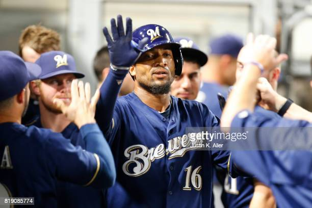 Domingo Santana of the Milwaukee Brewers celebrates after hitting a solo home run in the eighth inning against the Pittsburgh Pirates at PNC Park on...