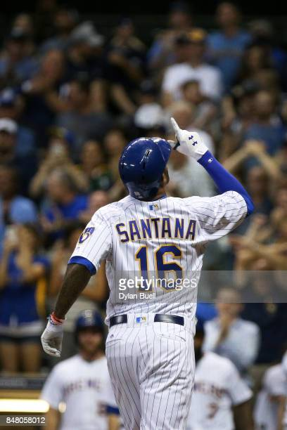 Domingo Santana of the Milwaukee Brewers celebrates after hitting a home run in the eighth inning against the Miami Marlins at Miller Park on...