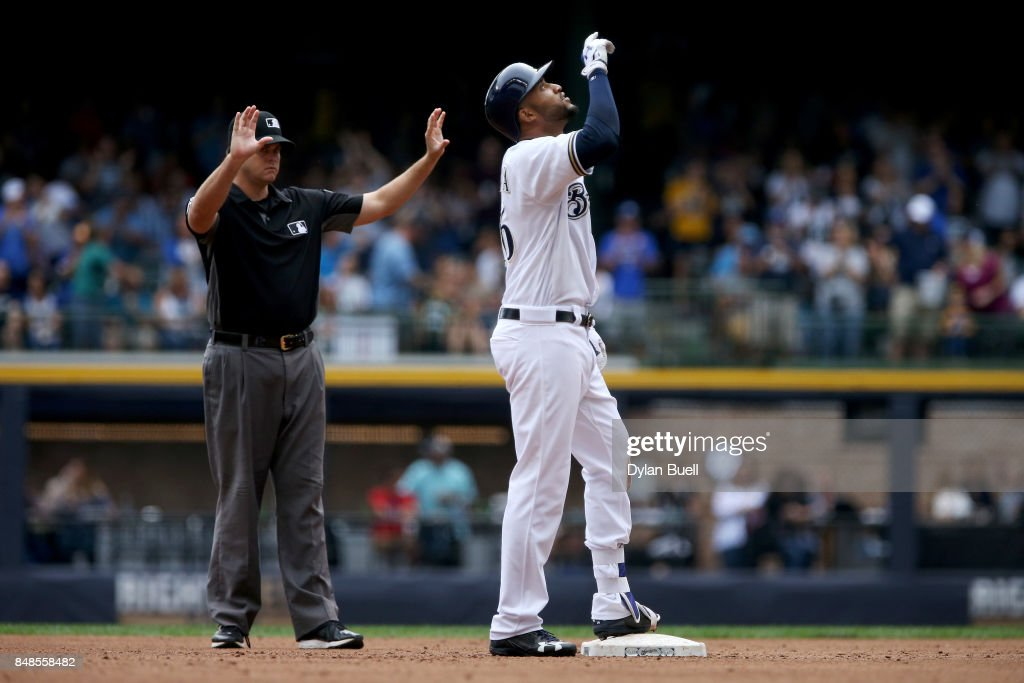 Domingo Santana #16 of the Milwaukee Brewers celebrates after hitting a double in the fourth inning against the Miami Marlins at Miller Park on September 17, 2017 in Milwaukee, Wisconsin.