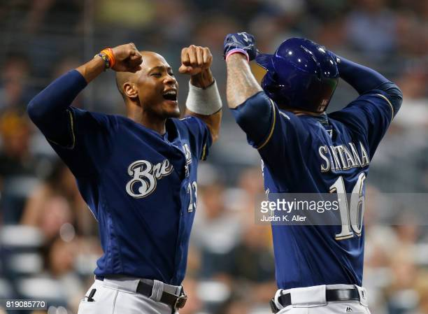 Domingo Santana of the Milwaukee Brewers celebrates with Keon Broxton of the Milwaukee Brewers after hitting a solo home run in the eighth inning...