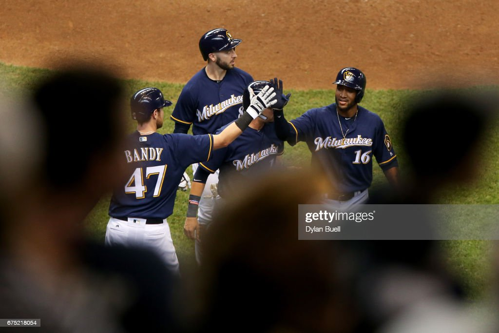 Domingo Santana #16 of the Milwaukee Brewers celebrates with teammates after hitting a home run in the sixth inning against the Atlanta Braves at Miller Park on April 30, 2017 in Milwaukee, Wisconsin.