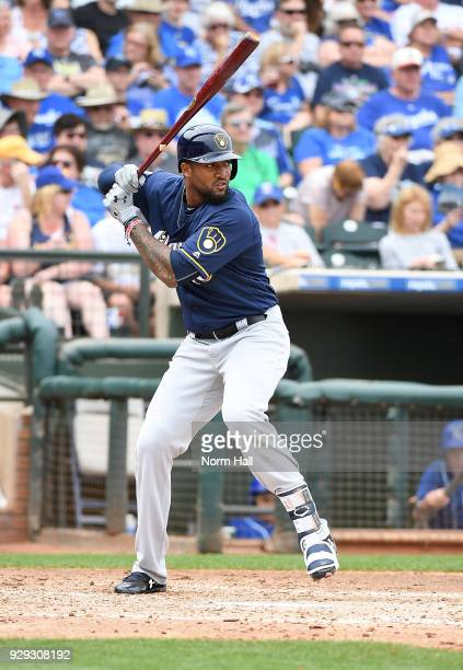 Domingo Santana of the Milwaukee Brewers gets ready in the batters box during a spring training game against the Kansas City Royals at Surprise...