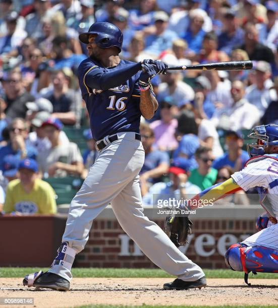 Domingo Santana of the Milwaukee Brewers hits a double in the 3rd inning against the Chicago Cubs at Wrigley Field on July 6 2017 in Chicago Illinois