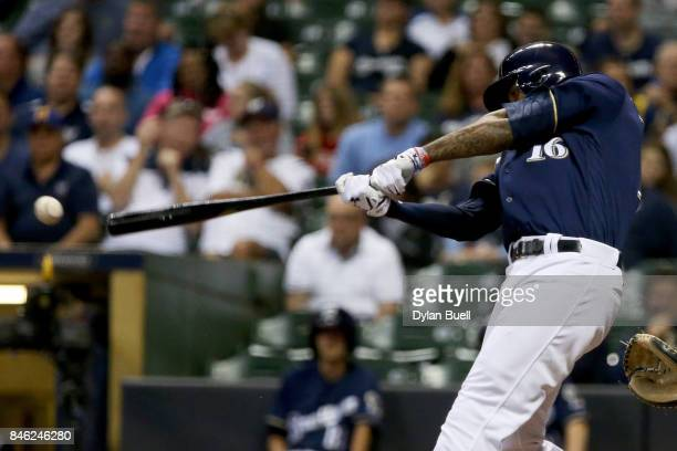 Domingo Santana of the Milwaukee Brewers hits a double in the third inning against the Pittsburgh Pirates at Miller Park on September 12 2017 in...