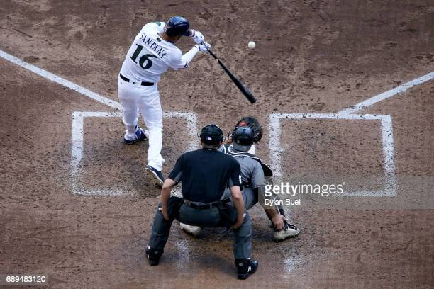 Domingo Santana of the Milwaukee Brewers hits a grand slam in the fifth inning against the Arizona Diamondbacks at Miller Park on May 28 2017 in...