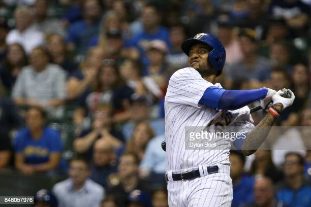 Domingo Santana of the Milwaukee Brewers hits a home run in the eighth inning against the Miami Marlins at Miller Park on September 15 2017 in...