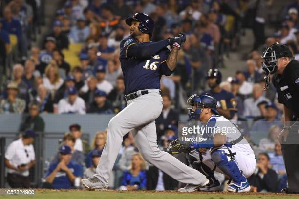 Domingo Santana of the Milwaukee Brewers hits a RBI single off Rich Hill of the Los Angeles Dodgers during the fifth inning in Game Four of the...
