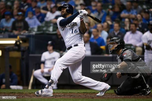 Domingo Santana of the Milwaukee Brewers hits a sacrifice fly in the sixth inning against the Arizona Diamondbacks at Miller Park on May 22 2018 in...