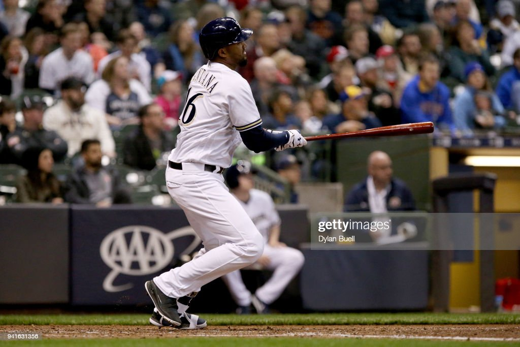 Domingo Santana #16 of the Milwaukee Brewers hits a single in the fifth inning against the St. Louis Cardinals at Miller Park on April 3, 2018 in Milwaukee, Wisconsin.