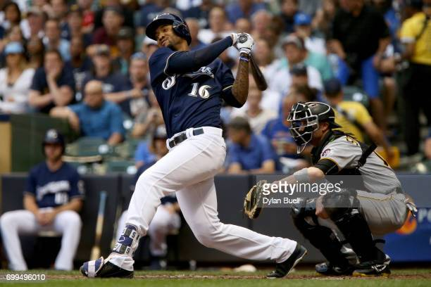 Domingo Santana of the Milwaukee Brewers hits a single in the third inning against the Pittsburgh Pirates at Miller Park on June 21 2017 in Milwaukee...