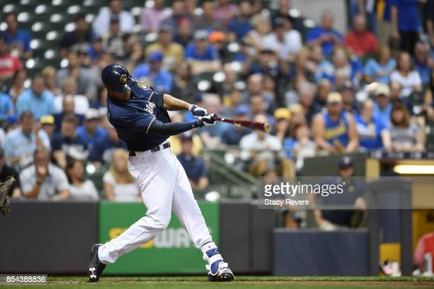 Domingo Santana of the Milwaukee Brewers hits a three run home run during the first inning against the Cincinnati Reds at Miller Park on September 26...