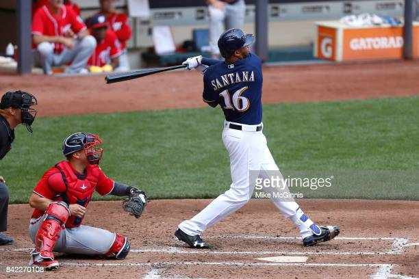 Domingo Santana of the Milwaukee Brewers hits a two run homer during the fourth inning against the Washington Nationals at Miller Park on September...