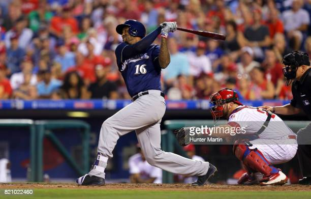 Domingo Santana of the Milwaukee Brewers hits an RBI single in the third inning during a game against the Philadelphia Phillies at Citizens Bank Park...