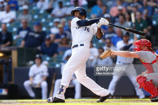 Domingo Santana of the Milwaukee Brewers makes some contact at the plate during the game against the Cincinnati Reds at Miller Park on September 28...