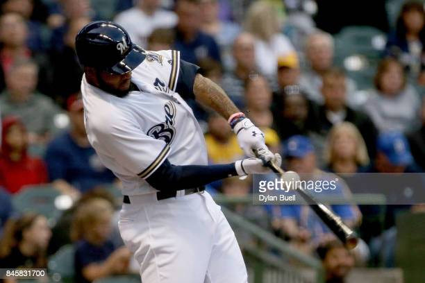 Domingo Santana of the Milwaukee Brewers pops out in the first inning against the Pittsburgh Pirates at Miller Park on September 11 2017 in Milwaukee...