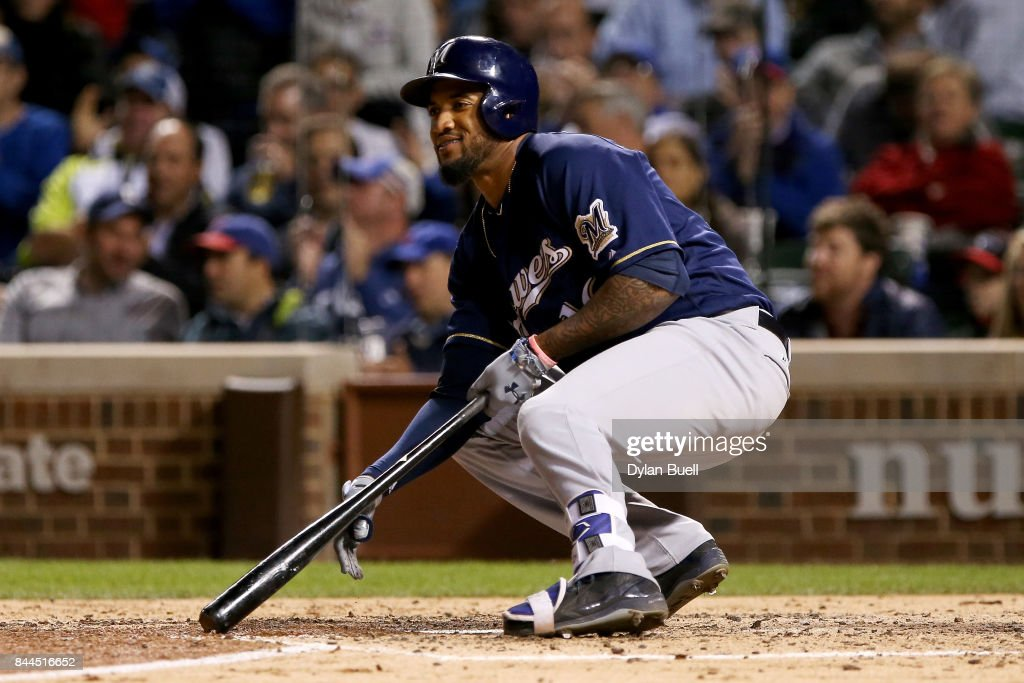 Domingo Santana #16 of the Milwaukee Brewers reacts after striking out in the sixth inning against the Chicago Cubs at Wrigley Field on September 8, 2017 in Chicago, Illinois.