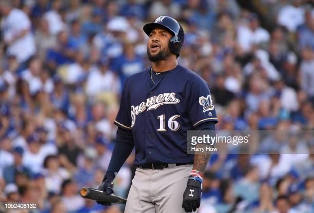 Domingo Santana of the Milwaukee Brewers reacts after striking out swinging during the eighth inning of Game Five of the National League Championship...