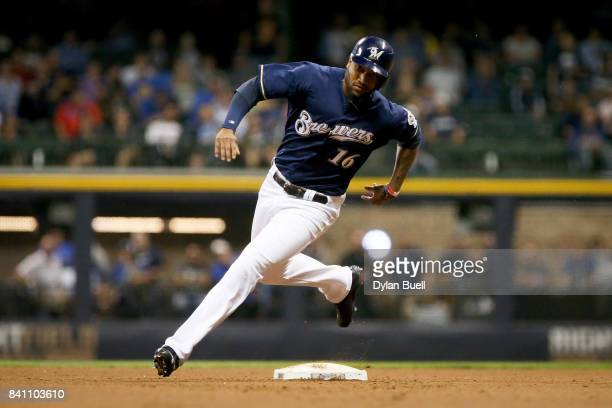 Domingo Santana of the Milwaukee Brewers rounds second base in the sixth inning against the St Louis Cardinals at Miller Park on August 29 2017 in...