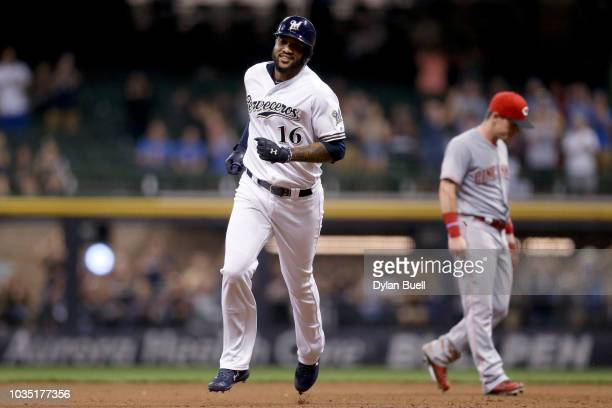 Domingo Santana of the Milwaukee Brewers rounds the bases after hitting a home run in the fifth inning against the Cincinnati Reds at Miller Park on...