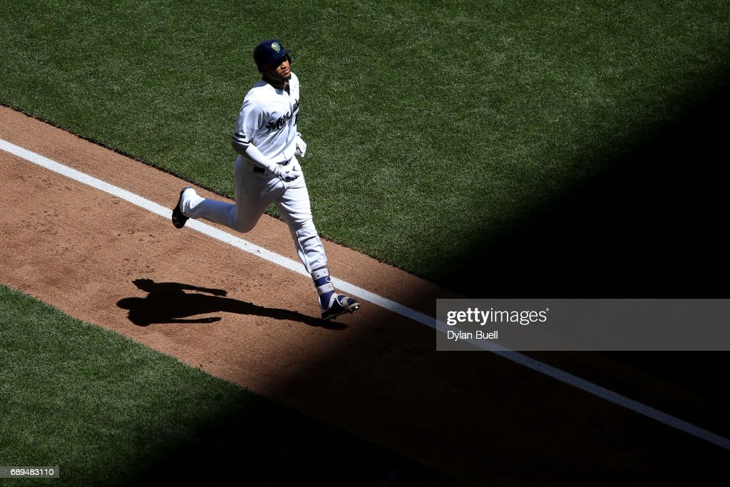 Domingo Santana #16 of the Milwaukee Brewers rounds the bases after hitting a grand slam in the fifth inning against the Arizona Diamondbacks at Miller Park on May 28, 2017 in Milwaukee, Wisconsin.