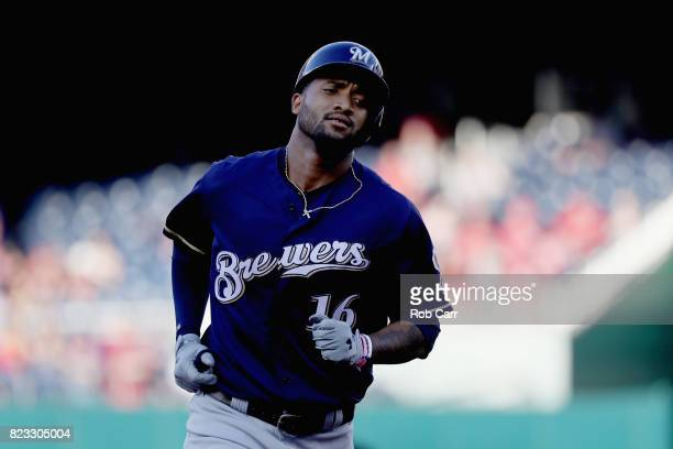 Domingo Santana of the Milwaukee Brewers rounds the bases after hitting a solo home run against the Washington Nationals at Nationals Park on July 26...