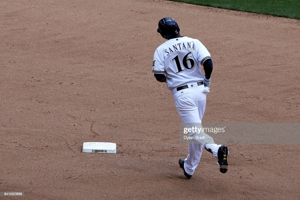 Domingo Santana #16 of the Milwaukee Brewers rounds the bases after hitting a home run in the sixth inning against the St. Louis Cardinals at Miller Park on August 30, 2017 in Milwaukee, Wisconsin.